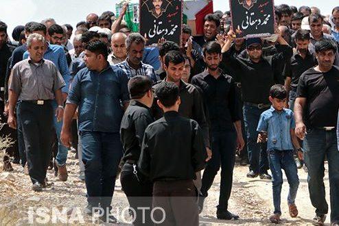 خاکسپاری پیکر محیط بان شهید محمد دهقانی در روستای سیاهک حاجی آباد